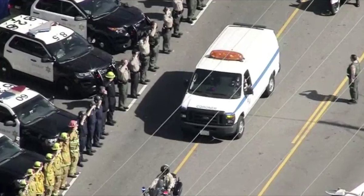 Image for the Tweet beginning: Officers salute a fallen Los
