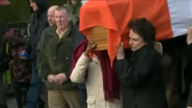 Martin McGuinness's wife, Bernie, helps carry his coffin as his body i...