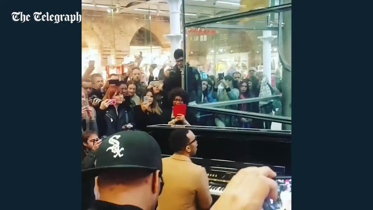 John Legend surprises commuters with an impromptu gig at St Pancras St...
