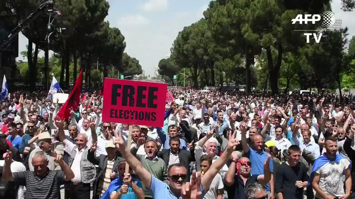 Thousands of opposition supporters protest in Albania's capital of Tirana to call for the resignation of Prime Minister Edi Rama