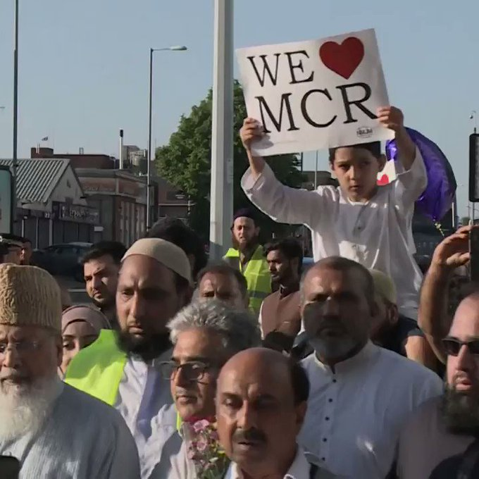 Muslims march for peace in Manchester, laying flowers and praying at the site of Monday's terror attack.