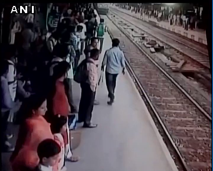 #WATCH Dramatic visuals: Girl survives after being run over by a train in Mumbai