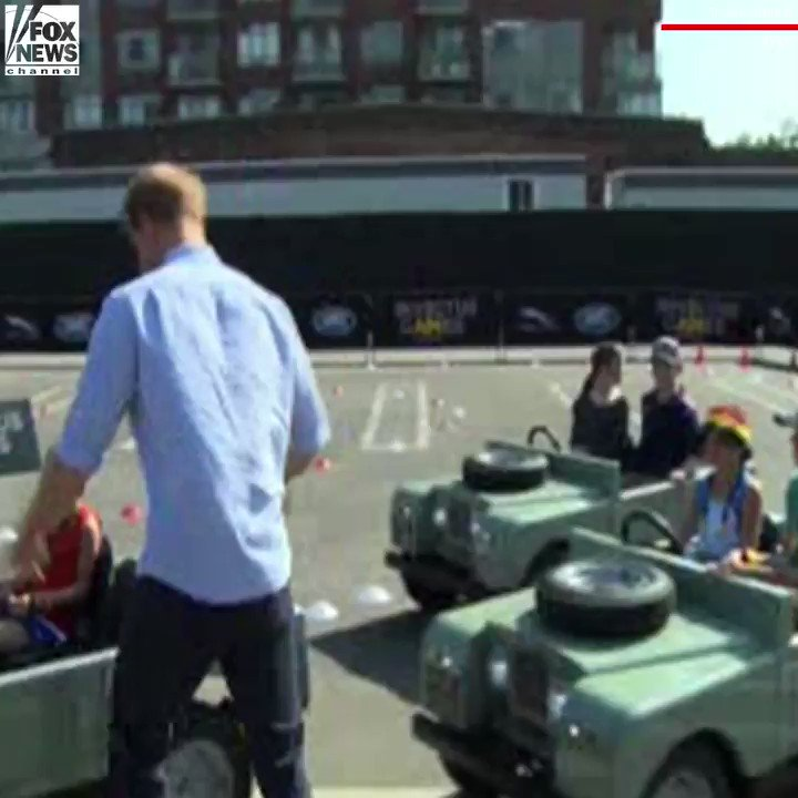 Prince Harry climbed aboard a mini SUV and let a 5-year-old drive him...