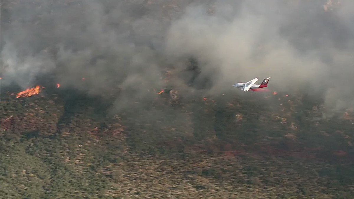 Firefighters drop fire retardant on #LibertyFire in Murrieta