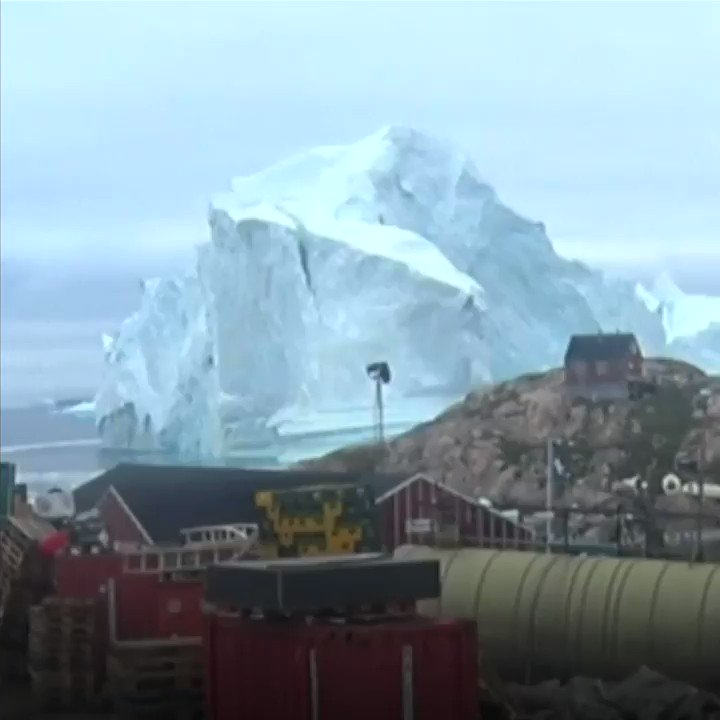 A huge iceberg is looming over a village in Greenland  https://t.co/eqGmt7Yoeg https://t.co/5VFnzmVAl8