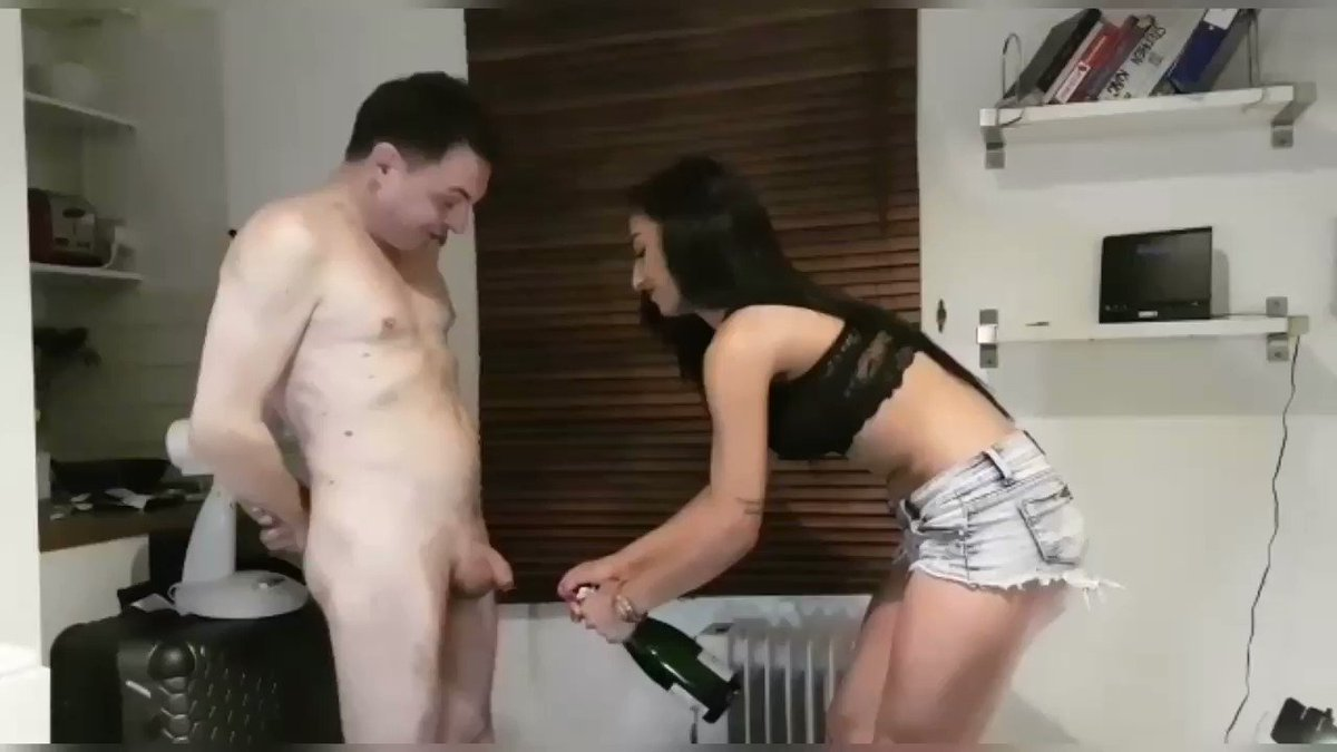 Goddess Nicole @GoddessNicole01 untaps a bottle of champagne straight in  the balls of her slave