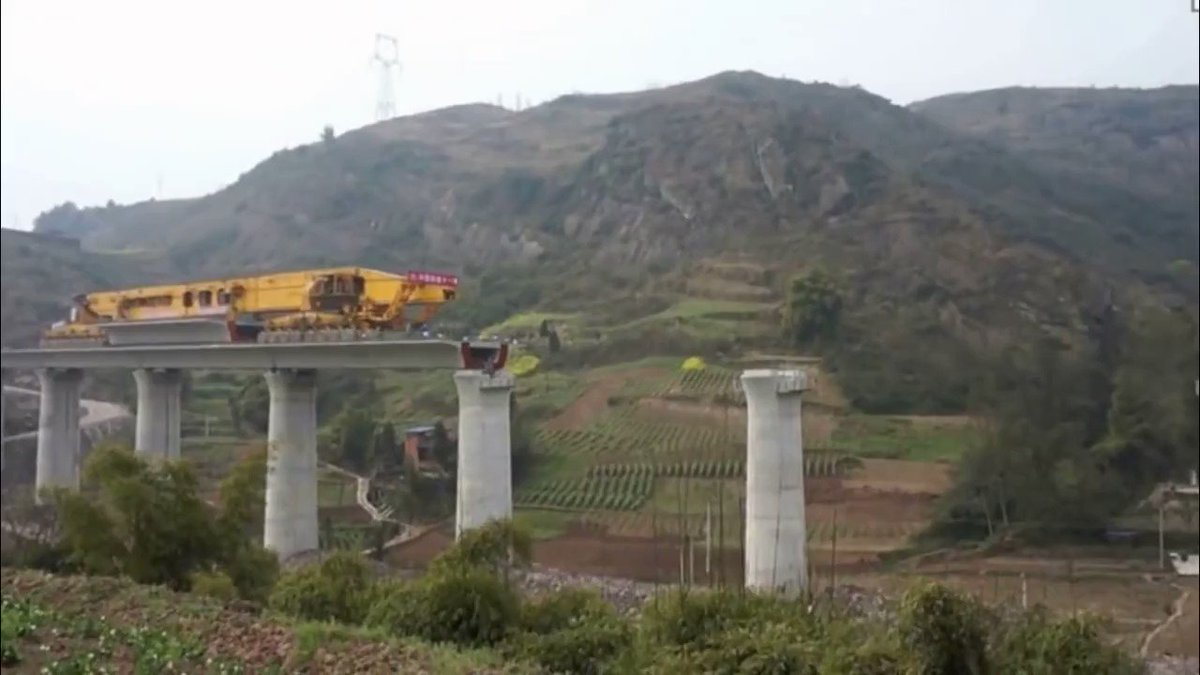 """A """"girder erection machine"""" laying its own track in China"""