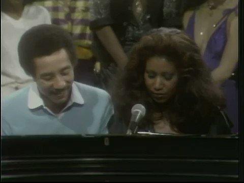 "Aretha Franklin and Smokey Robinson singing ""ooo baby baby"""