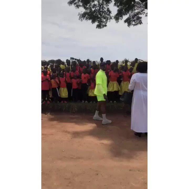 Kanye West gives Yeezy's out to kids in Uganda! 🇺🇬👀 Via: @KimKardashian