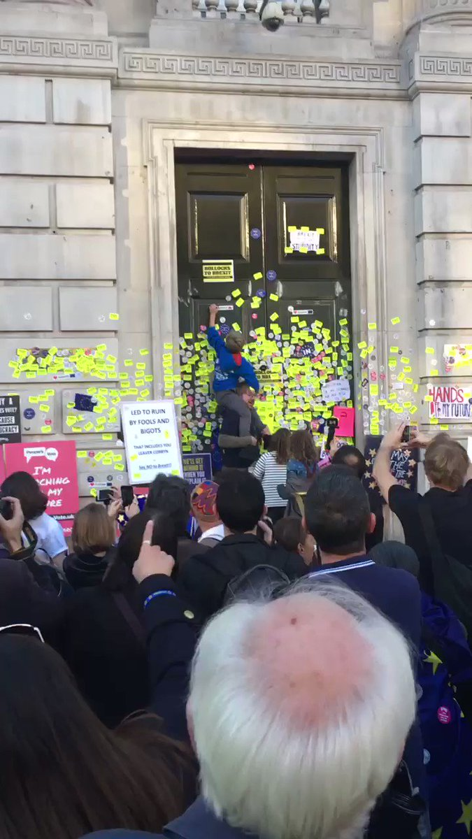 This is what happens when you give children stickers. I've spent many hours scraping stickers off windows, walls & floors, when my children were toddlers. Thankfully they did grow out of it. Street cleaners will be busy tonight. #PeoplesVoteMarch