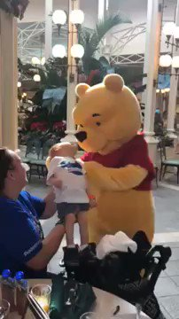 """""""For those of you who have disabled children know the feeling when people look but aren't sure how to interact w/ your kiddo. This Winnie the Pooh melted my heart and knew exactly what to do!""""- Jessie  Winnie the Pooh spent 10 min comforting a disabled little boy ❤️😭  RETWEET"""