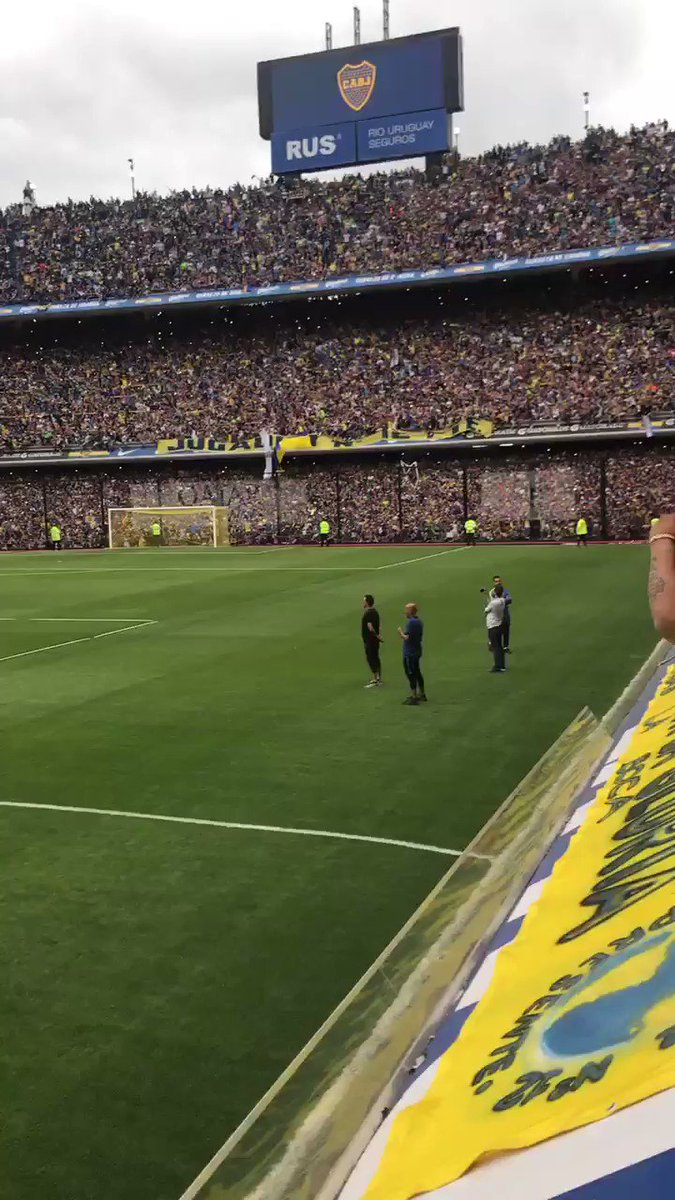 Boca Juniors fans at a training session. A training session. There's such a thing as liking football too much.