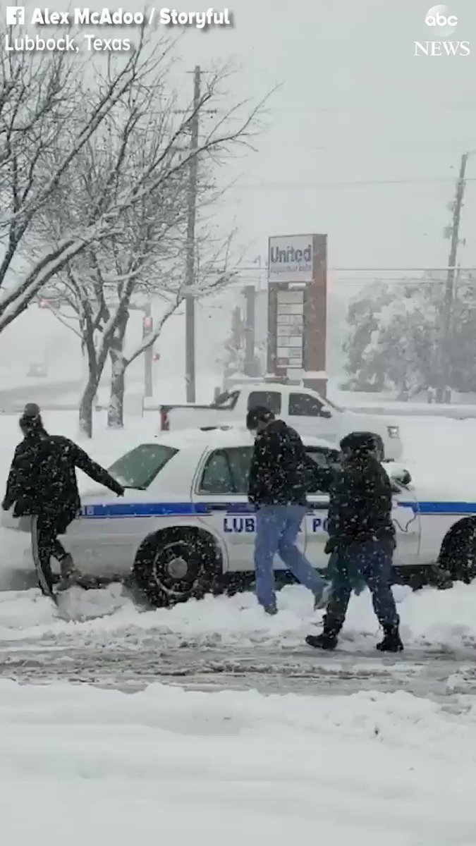 HELPING HAND: Good Samaritans come to the aid of a stuck police officer in Lubbock, Texas, dislodging his cruiser so he could get back on the road. More than 10 of snow dropped across parts of Lubbock on Saturday. abcn.ws/2RL0ycQ