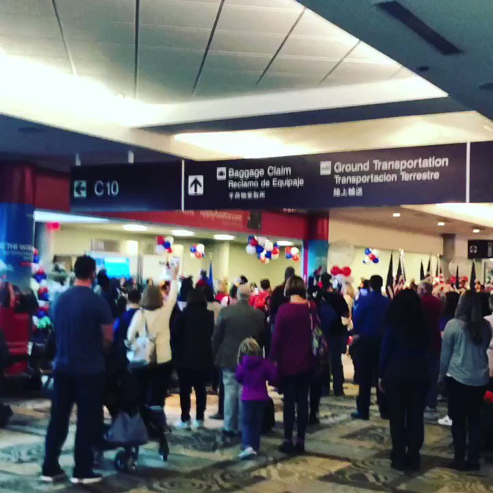 A group of passengers at Nashville International Airport stopped to sing 'The Star-Spangled Banner,' and pay respects to children who had lost their parent(s) while in combat. They were leaving (kids/families) on an all expense paid trip to Disney World.