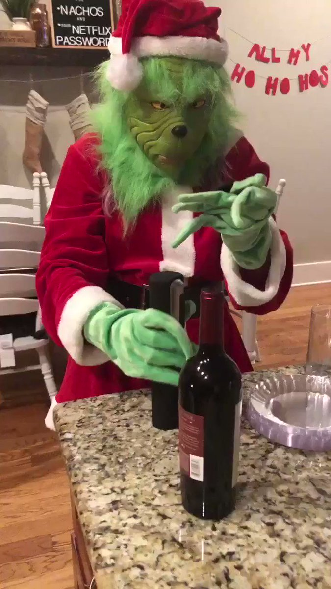 the grinch needs some wine to get through the holidays