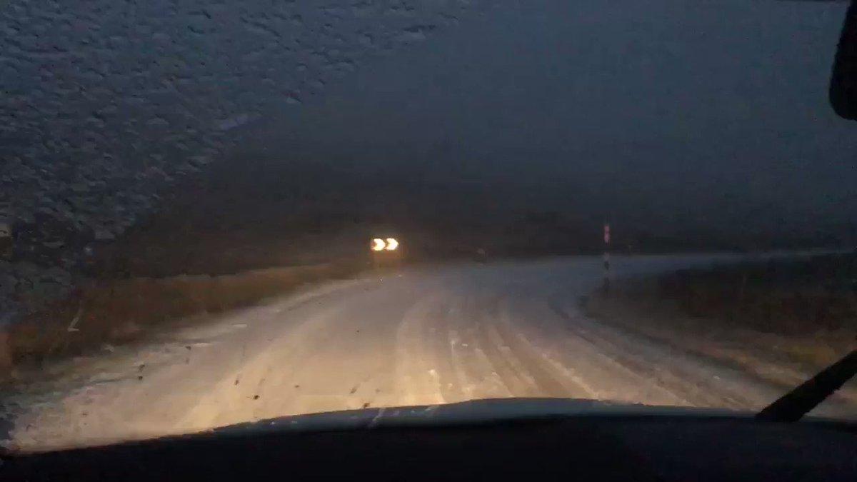Treacherous road conditions here in County Durham - Snow settling on top of freezing rain #UKSnow #FreezingRain #StormDeirdre @StormHour @metoffice @county_weather