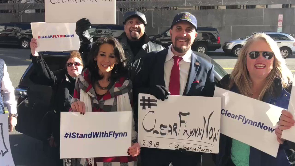 """Group Flynn supporters in the cold chanting """"Clear Flynn Now"""" outside courthouse"""