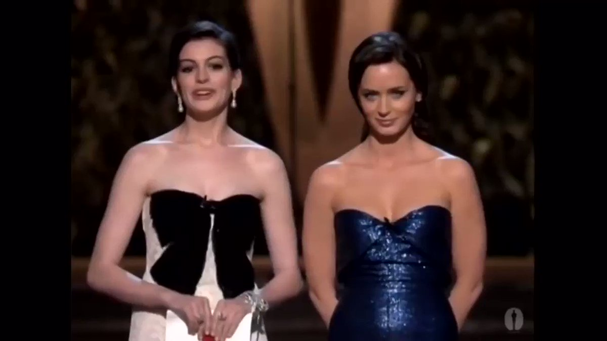 Emily Blunt and Anne Hathaway presenting with this iconic 'Devil Wears Prada' moment (2007)