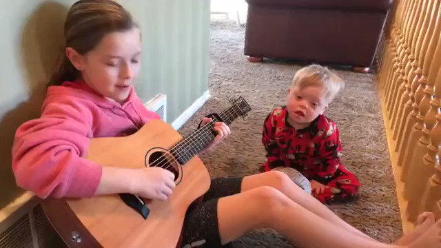 A mom captured this beautiful moment when she saw her daughter singing to her baby brother.  She uses singing as a method of speech therapy so her little brother w/down syndrome can learn to speak and it is working.