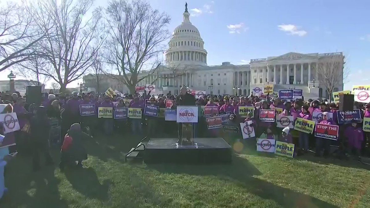 """""""Open the government... today!""""  Members of the National Air Traffic Controllers Association hold an anti-shutdown rally outside the US Capitol."""