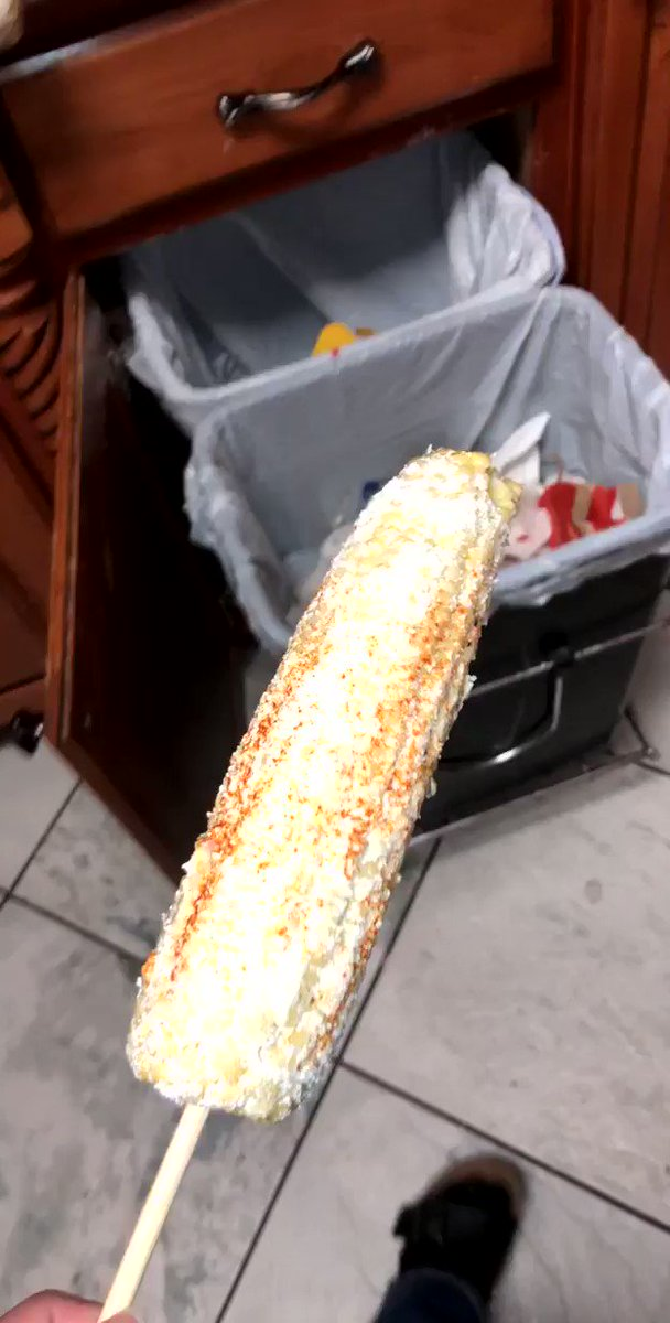 This is how you eat an elote.