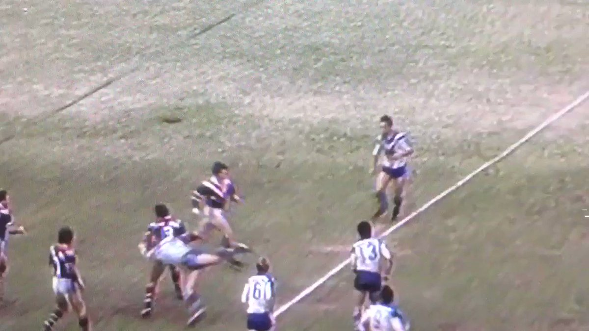 Royce Ayliffe with a cheeky head butt on Chris Mortimer and cops a punch in the head for his troubles.Bulldogs vs Roosters 1980 GF#bringbackthebiff #biff #fight #oldschool #classic #NRL