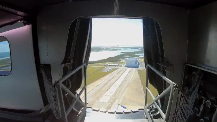 View of Launch Complex 39A and Crew Dragon from the crew access arm