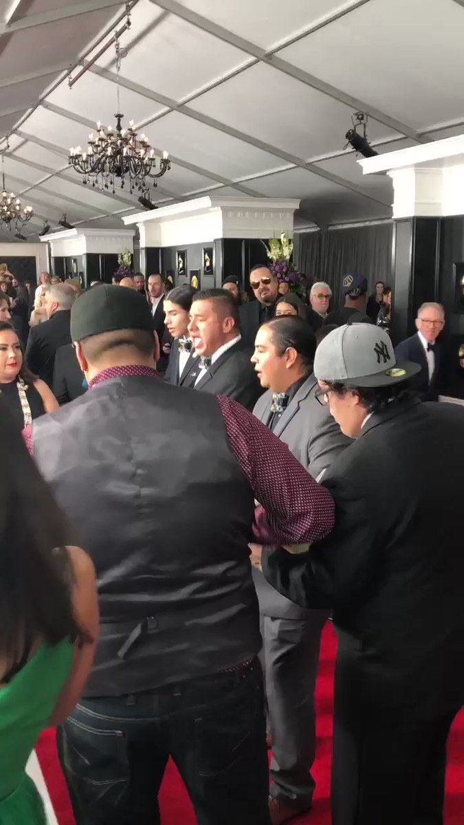 """Crowd gathers to listen to Frog Lake, Alberta-based group Young Spirit perform what they told me is a Cree round dance. They were nominated for best regional roots album. Said they hope the music inspires Indigenous youth to """"stand up and be proud"""" #Grammy2019"""