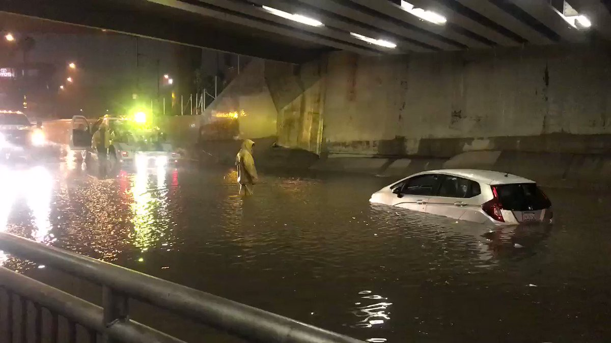 Tow truck driver is working to pull this car out of flooded underpass near Douglas and Katella in Anaheim. Luckily, the driver was able to get out safely. She says the water was only up to her tires when she tried to drive through. @CBSLA