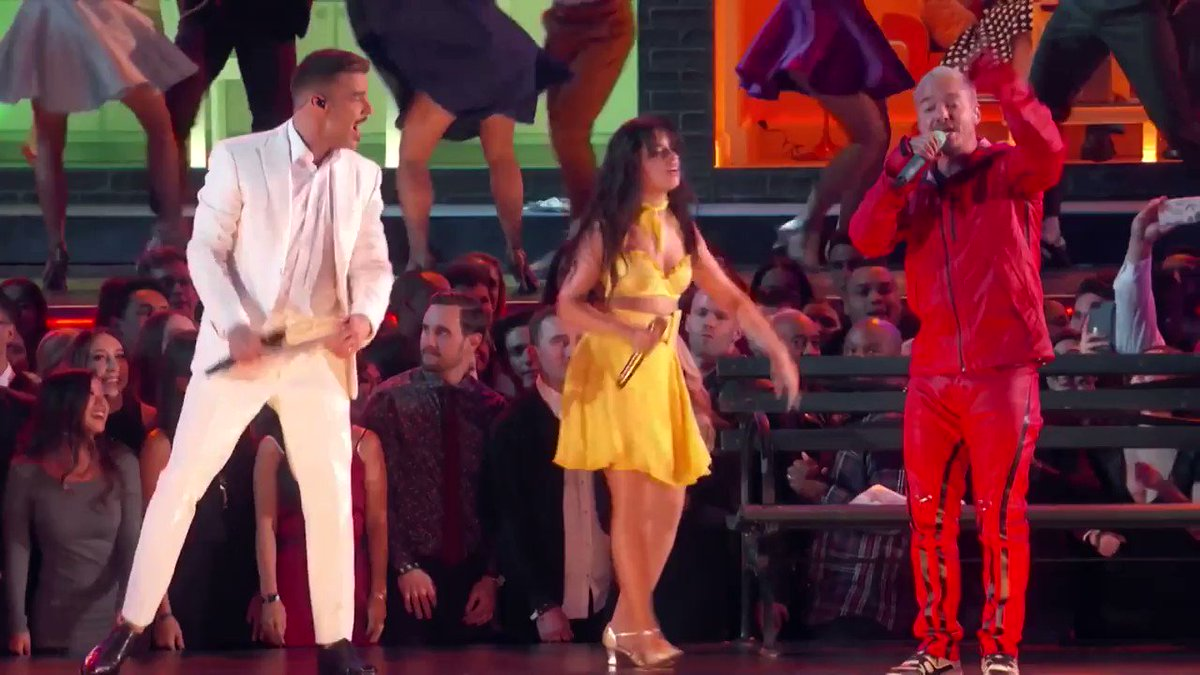 """Bringing her grandmother's story to life onstage, @Camila_Cabello performed her GRAMMY-nominated song """"Havana.""""  Watch her, @ricky_martin, @JBALVIN, @youngthug, and @sandovalarturo1 open the 61st #GRAMMYs: http://grm.my/2TKp2ny"""