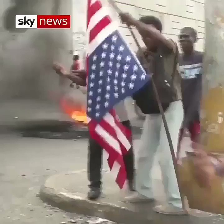 Anti-government protesters in #Haiti burn the 🇺🇸#US flag.