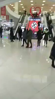 Meanwhile - shopping mall in Kiev adorned with a giant swastika