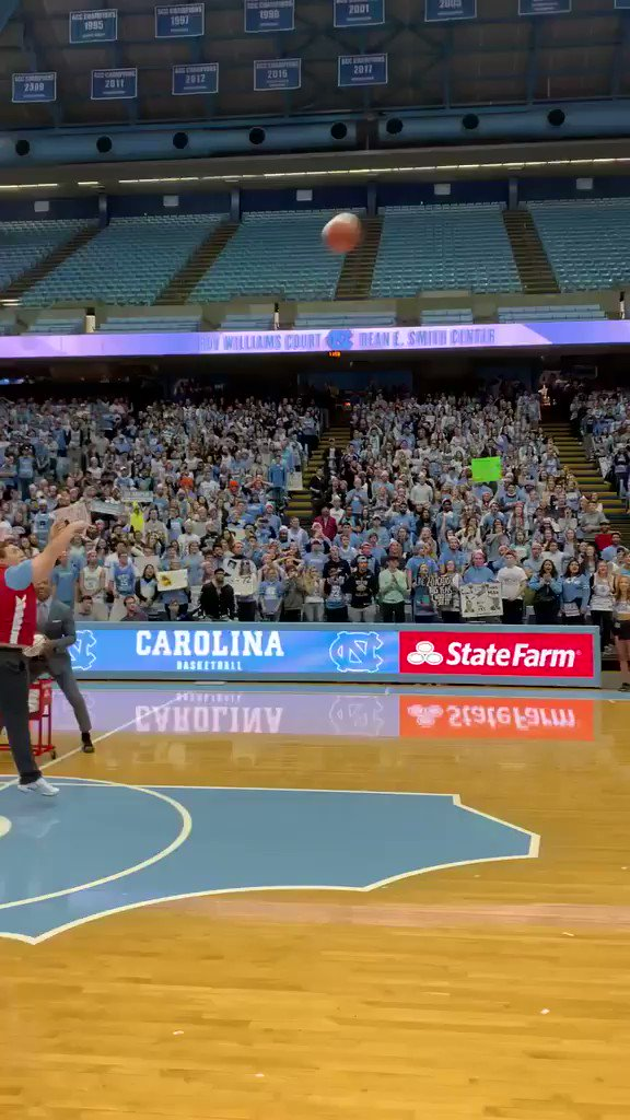 ✅ Drill the half-court shot ✅ Mobbed by UNC players ✅ $19,000 check   One helluva Saturday for this Tar Heel!