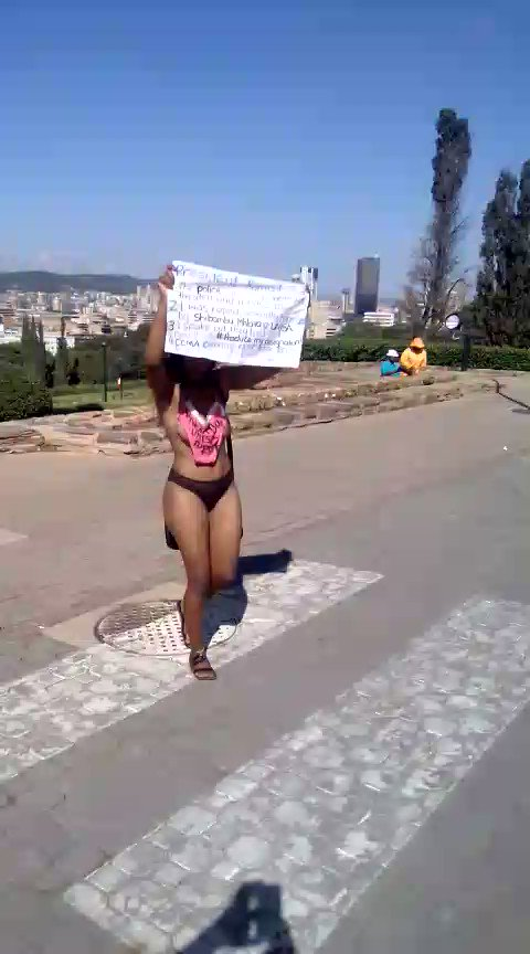 Gugu Ncube staged a nude protest at Union Buildings today due to alleged sexual abuse she experienced at UNISA. She has now been arrested.