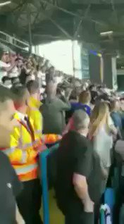 A Leeds united fan having a casual crowd surf during the game...