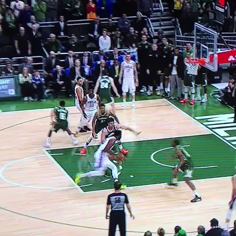 10 seconds later, Simmons tip slams on Giannis' head and primal screams in his grill let's go