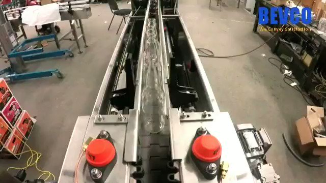 Take a tour through BEVCO's Rinser! We connected the infeed & outfeed for a test run, providing bottles with a happy carousel  This rinser uses ionized air, but a water rinse is also available. Our rinsers are versatile! :)  #Rinser #packaging #manufacturing #beer #productionline