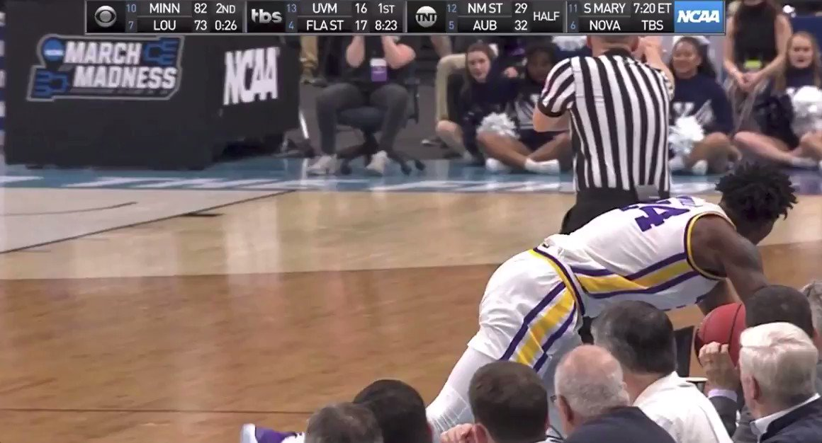 LSU's Emmitt Williams destroyed an innocent Coke Zero while crashing into the scorer's table