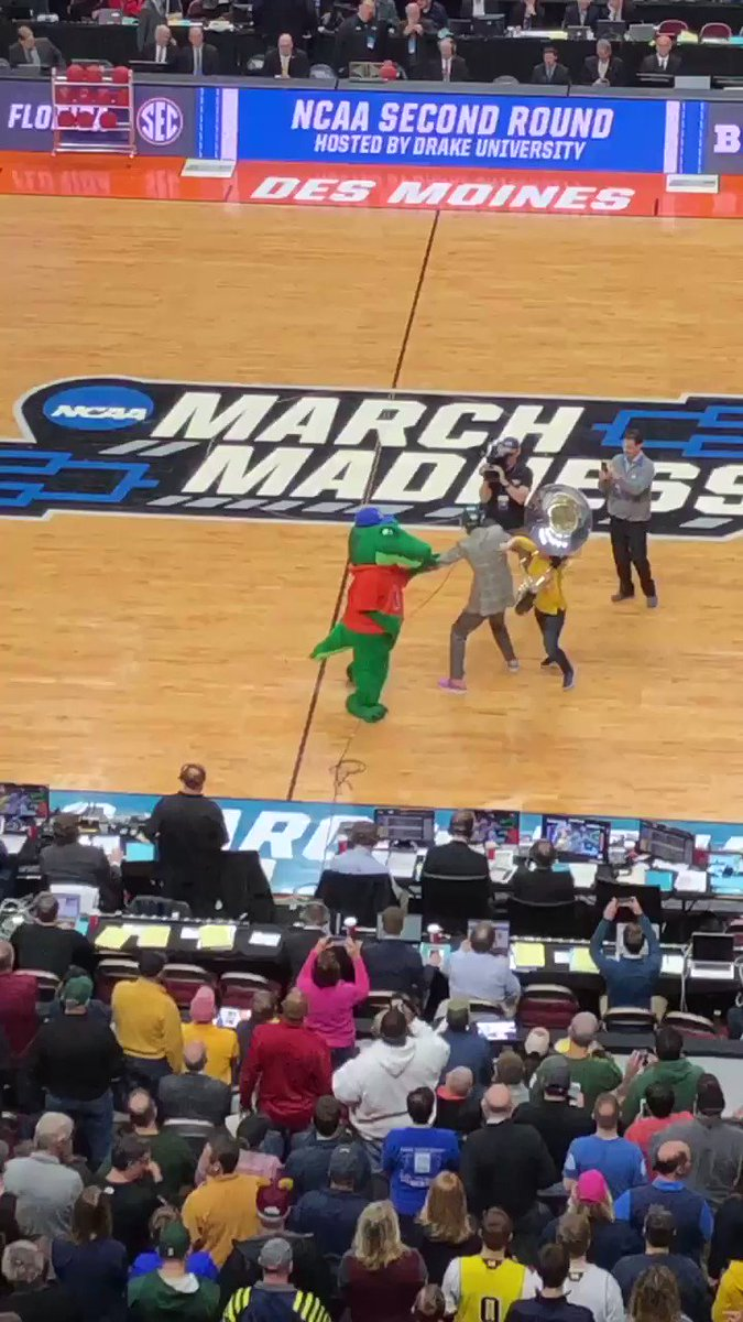 """If you're asking yourself """"Is that Reggie Miller keeping the peace between the Florida mascot Albert and a Michigan tuba player?"""" The answer is yes.  (Credit the tuba player with a solo tackle)"""