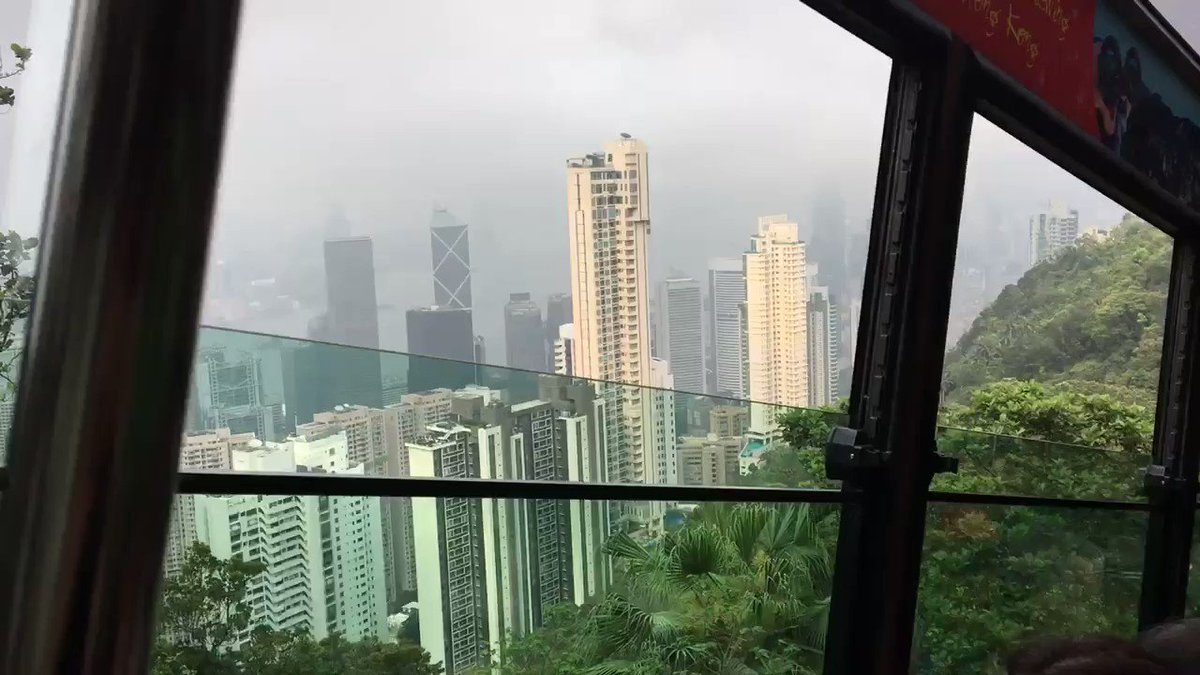 """The tram to and from #VictoriaPeak in #HongKong is just about the most fun thing ever! I scoffed when I read it was """"gravity defying"""" but omg. I didn't record the near-vertical bits but...just omg, so fun. The only way I'll go up there from now on!! #TravelTribe #PassionPassportpic.twitter.com/WpKJENWNZI"""
