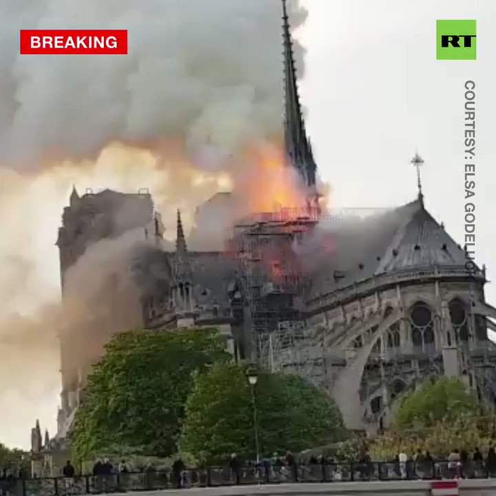 Smoke and fire is seen leaping from the top of Notre Dame, the iconic Paris cathedral.Videos shot by people show the blaze engulfing the spire between its bell towers  #NotreDame  MORE: http://on.rt.com/9sbk