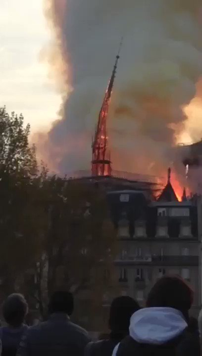 Heartbreaking footage of the Notre Dame spire falling. The cathedral was built in the 12th century, a piece of history crumbling before our eyes