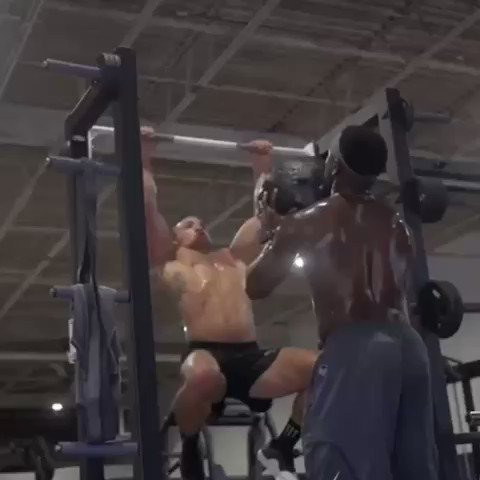 Watch Bellator champ Michael Chandler's insane pull-up routine with a medicine ball