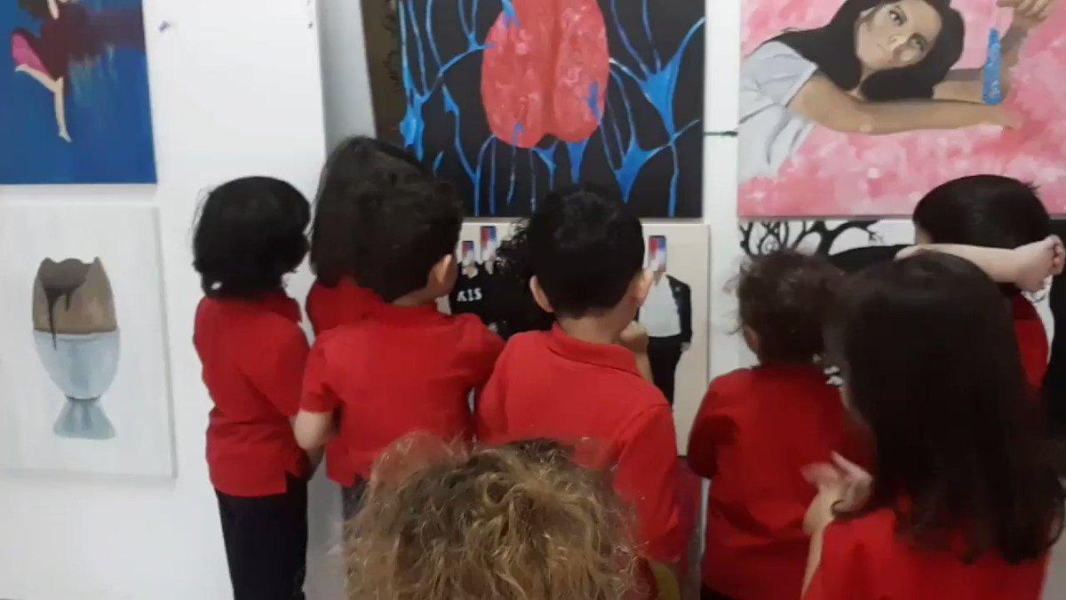 #aisq8PreK Budding art critics critiquing the art works of #aisq8hs visual arts students 👩🎨👨🎨