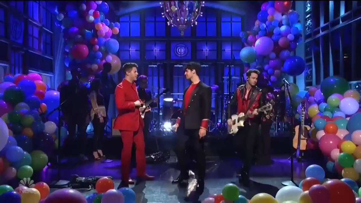 "Jonas Brothers performing ""Burning Up"" on SNL."
