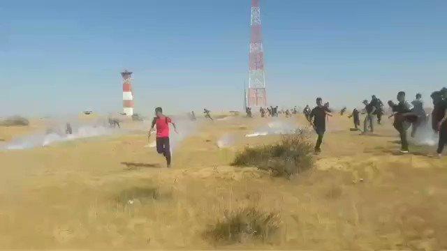 IDF dispersing Palestinians with tear gas today at the #Gaza border. #Israel #Nakba71