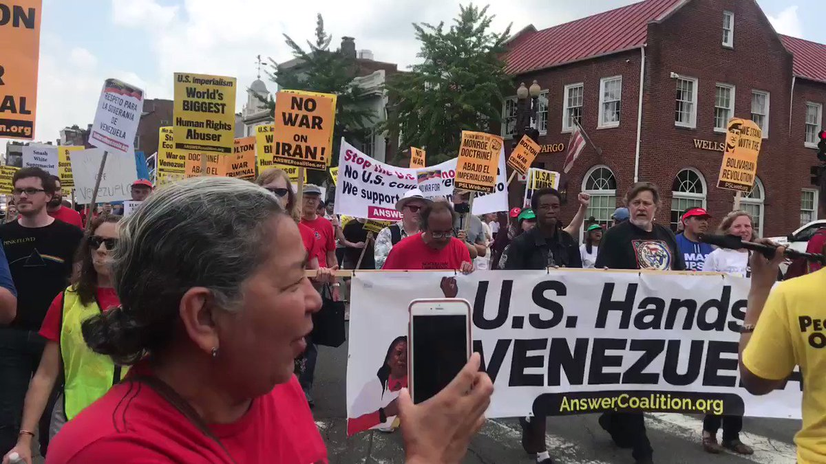 """Now in the streets of Washington DC: """"@AmbJohnBolton you can't hide, we charge you with genocide."""" #HandsOffVenezuela"""