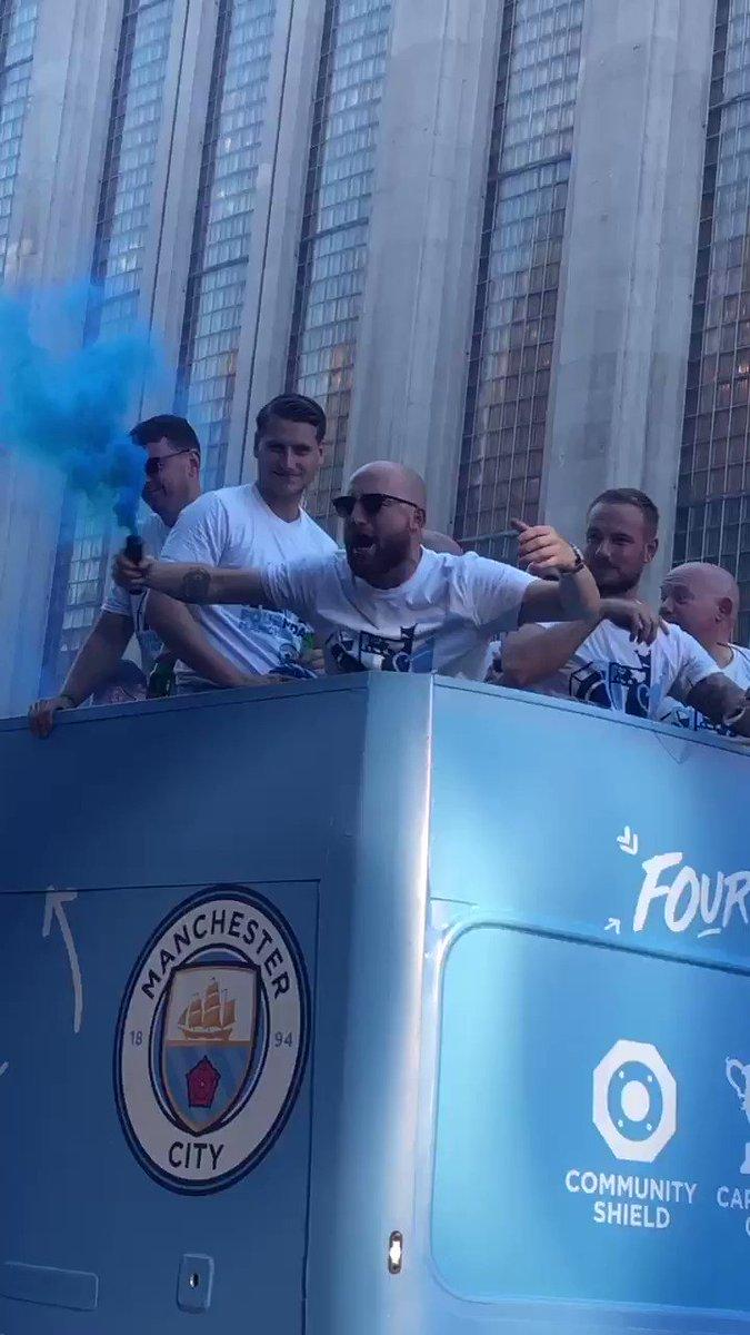 Man City's Kitman Brandon Ashton is enjoying the parade!#MCFC