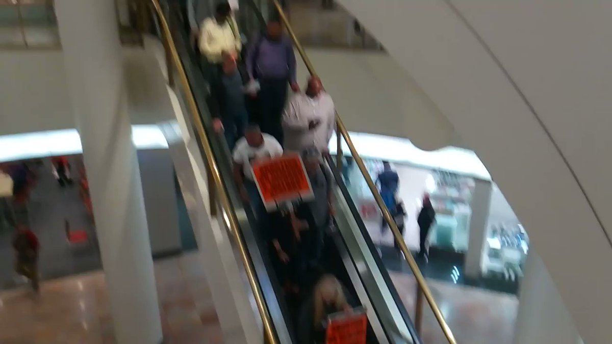 """Down the escalator at Westfield Mall in San Francisco.  """"Abortion on demand and without apology""""."""
