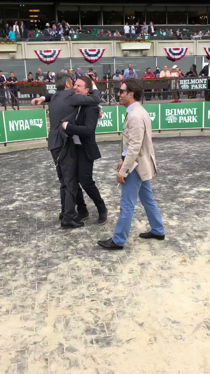 The Alessandro Botti team goes wild after Amade (Ire) closes to win the GII Belmont Gold Cup.